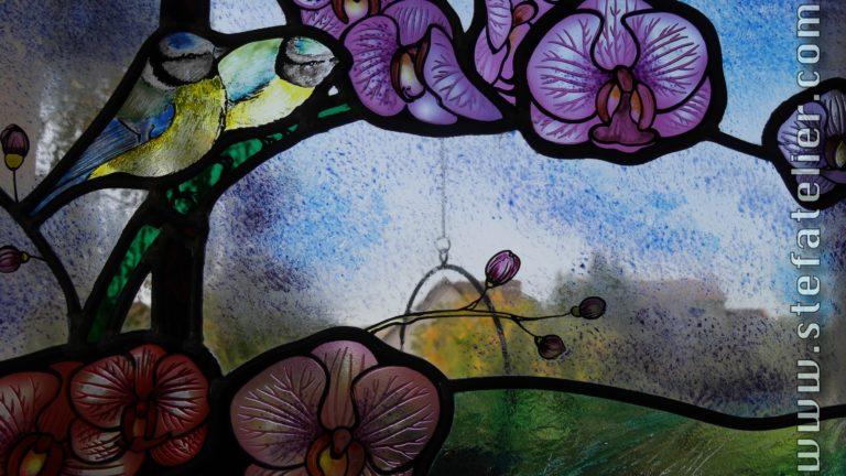 orchidées et mésanges en vitrail traditionnel au plomb